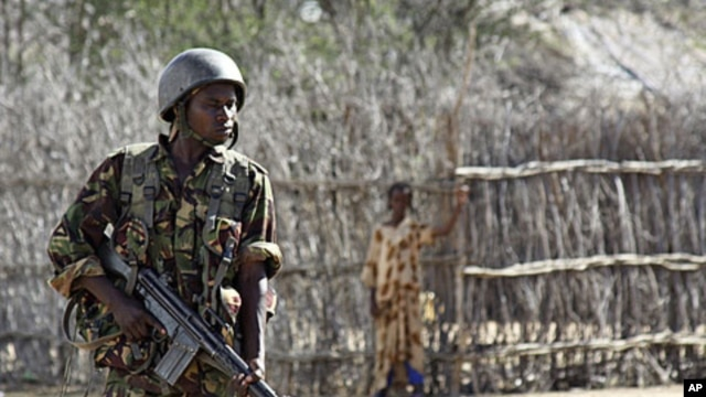 A Kenyan soldier stands guard an airstrip in an area near the Somali-Kenyan border where al-Shabab militants are active (file photo).