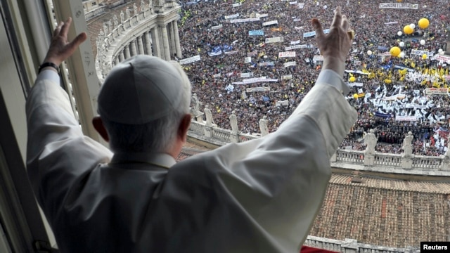 Pope Benedict waves to the crowd gathered in St. Peter's square during his weekly Angelus blessing at the Vatican, May 16, 2010.
