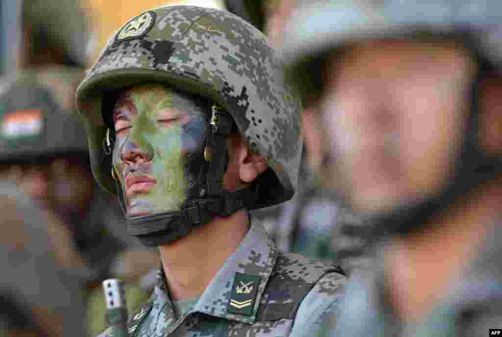 "A People's Liberation Army (PLA) of China soldier looks on after participating in an anti-terror drill during the Sixth India-China Joint Training exercise ""Hand in Hand 2016"" at HQ 330 Infantry Brigade."