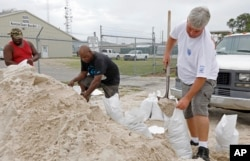 Gulfport, Miss., residents shovel sand into bags at a Harrison County Road Department sand bagging location, while preparing for Subtropical Storm Alberto to make its way through the Gulf of Mexico, May 26, 2018.