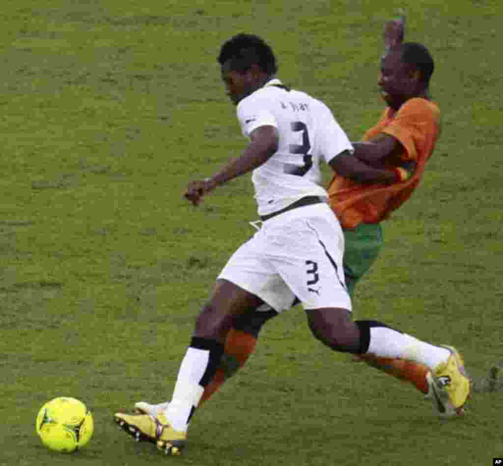 "James Chamanga of Zambia (back) fights for the ball with Asamoah Gyan of Ghana during their African Nations Cup semi-final soccer match at Estadio de Bata ""Bata Stadium"" in Bata February 8, 2012."