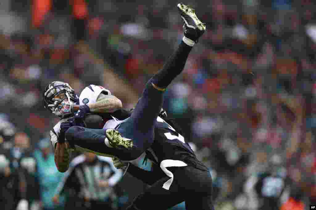 Jacksonville Jaguars cornerback Tre Herndon (37) hits Houston Texans wide receiver Kenny Stills (12) during the first half of an NFL football game at Wembley Stadium in London.
