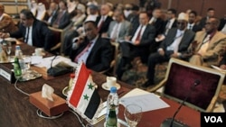 Pertemuan Liga Arab di Kairo yang tidak dihadiri oleh perwakilan Suriah (12/2).