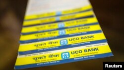FILE - Leaflets advertising loans are pictured inside a commercial branch of the UCO Bank in Mumbai.