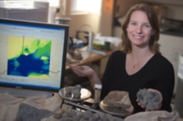 Alycia Stigall, in her laboratory, displays fossils and tools of her research.
