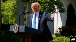 President Donald Trump speaks during a National Day of Prayer event in the Rose Garden of the White House, May 2, 2019.