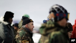 FILE - Vietnam Army veteran Dan Luker of Boston attends a briefing for fellow veterans at the Oceti Sakowin camp where people have gathered to protest the Dakota Access oil pipeline in Cannon Ball, N.D., Dec. 3, 2016.