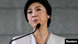 Thai Prime Minister Yingluck Shinawatra faces the media during a news conference at The Army Club in Bangkok, Dec. 10, 2013.