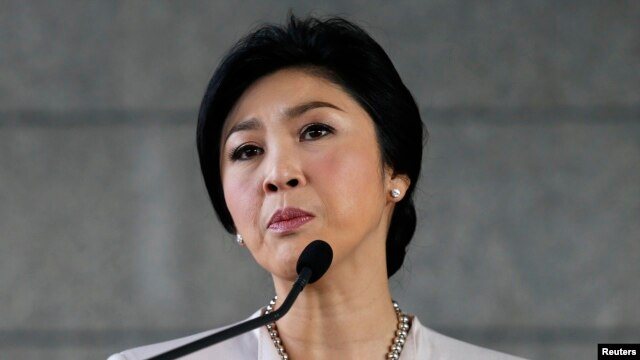 FILE - Thai Prime Minister Yingluck Shinawatra faces the media during a news conference at The Army Club in Bangkok, Dec. 10, 2013.