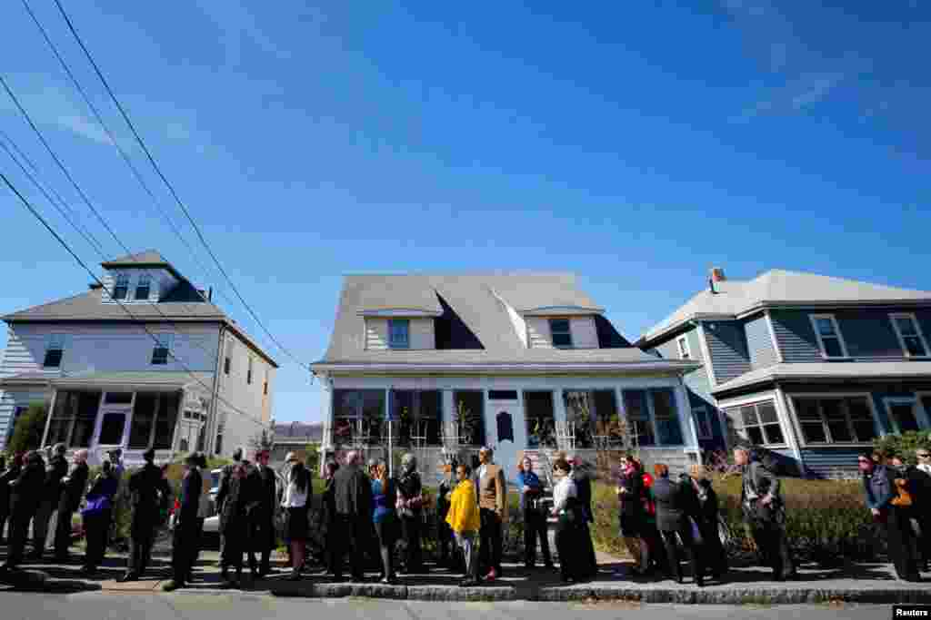 Hundreds of people wait in a line that extends around the block to pay their respects to the family of Krystle Campbell, April 21, 2013.