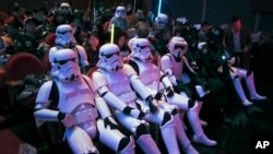 "Chinese fans, some dressing as Star Wars characters' costumes, wait for the premiere of ""Star Wars: The Force Awakens"" in Shanghai, China, Dec. 27, 2015."