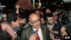 Mohamed ElBaradei talks to members of the media as he arrives at Cairo's airport in Egypt, Jan. 27, 2011