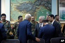 FILE - U.S. Defense Secretary James Mattis, meets with the defense minister and other members of the Afghan delegation at Resolute Support headquarters, in Kabul Afghanistan, April 24, 2017.