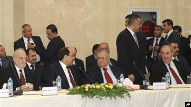 Leaders of Iraq's main political blocs, front row, from left to right: former Iraqi Prime Minister Ibrahim Jafari, Iraqi Prime Minister Nouri al-Maliki, Iraqi President Jalal Talabani and former Iraqi Prime Minister Ayad Allawi, are seen during their meet