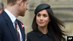 FILE - Britain's Prince Harry and Meghan Markle attend a Service of Thanksgiving and Commemoration on ANZAC Day at Westminster Abbey in London, April 25, 2018.
