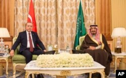 FILE - Turkish President Recep Tayyip Erdogan (L) and Saudi King Salman bin Abdul Aziz al-Saud pose for a photo during their meeting in Riyadh, Saudi Arabia, in this picture released, Dec. 29, 2015 by the office of the Saudi Press Agency.