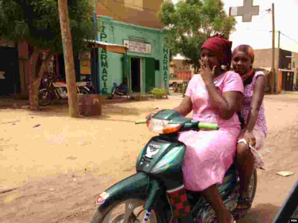 Two Gao women residents on a motorcycle. (Idriss Fall/VOA)