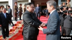 South Korean President Moon Jae-in shakes hands with North Korean leader Kim Jong Un during their summit at the truce village of Panmunjom, North Korea, May 27, 2018.