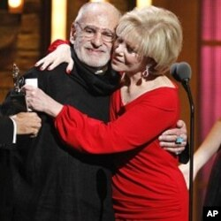 "Larry Kramer, left, is hugged by Daryl Roth after they won the Tony Award for Best Revival of a Play for ""The Normal Heart"" during the 65th annual Tony Awards, June 12, 2011 in New York."