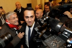 FILE - 5-Star Movement's leader Luigi Di Maio arrives for a press conference on the preliminary election results, in Rome, March 5, 2018.