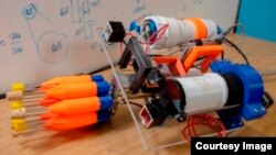 The robot contains eight orange spear tips, two small boxes just behind the carousel containing cameras, the electronics chamber behind the right camera, and a buoyancy chamber behind the left camera. (Worcester Polytechnic Institute)