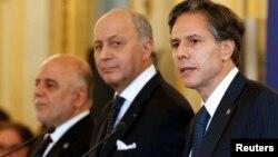 Dari kiri ke kana: PM Irak Haider al-Abadi, Menlu Perancis Laurent Fabius dan Wakil Menlu AS Antony Blinken dalam pertemuan di Paris, Perancis (2/6).