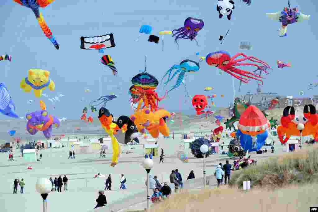 People fly kites during the international kite festival in Berck-sur-Mer, northern France.