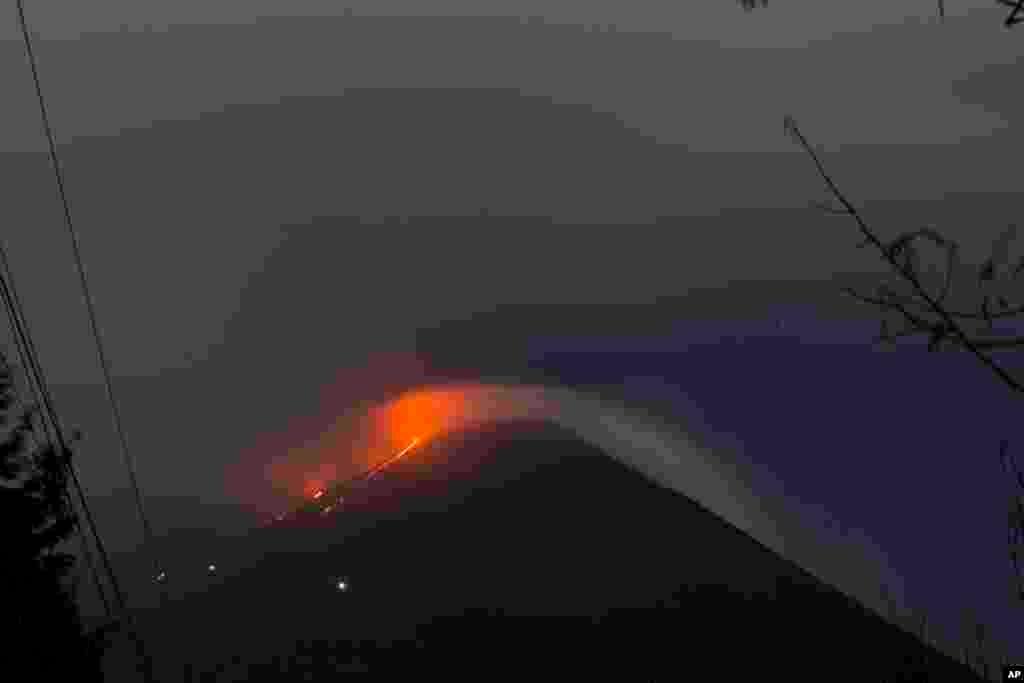 Pacaya volcano spews lava, viewed from San Vicente Pacaya, Guatemala.