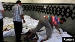 親人認領衝突中被打死死者的遺體
