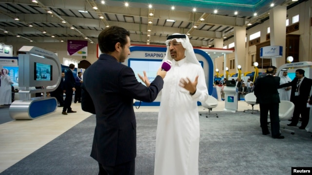 FILE - Saudi Aramco's then-CEO, Khalid al-Falih, speaks to reporter at Petrotech 2014, Bahrain International Exhibition Center, Manama, May 19, 2014.