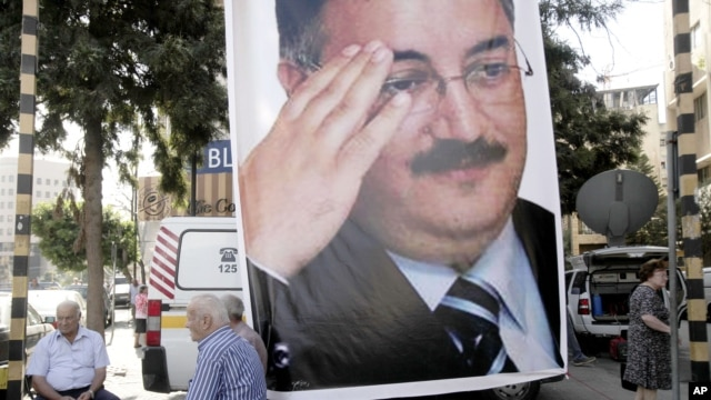 A memorial poster of  Brig. Gen. Wissam al-Hassan, who was assassinated Friday, hangs near the spot Friday's car bomb attack that killed Al-Hassan, in the Achrafiye district of Beirut, Lebanon, October 23, 2012.