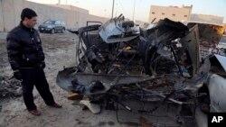 16일 이라크 바그다드에서 일어난 차량폭탄 공격 현장.