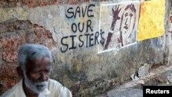 Des messages pour protester contre les viols sur enfants en Inde, à Kochi, le 16 avril 2018.