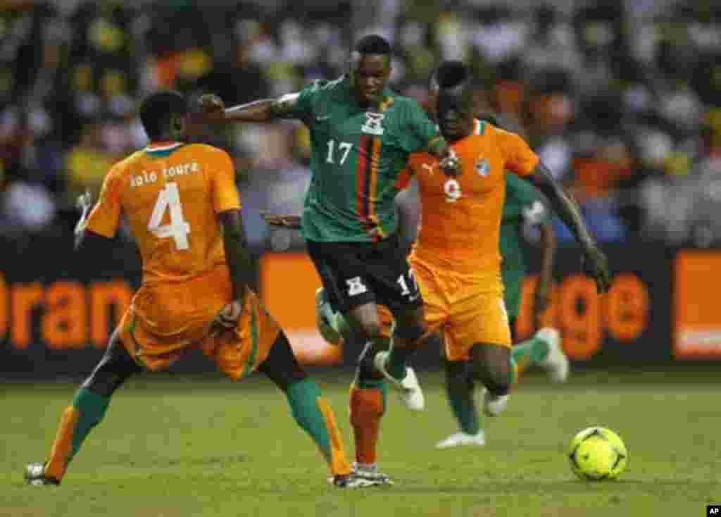 Zambia's Rainford Kalaba (L) challenges Kolo Toure (L) and Collins Mbesuma of Ivory Coast during their African Nations Cup final soccer match at the Stade De L'Amitie Stadium in Gabon's capital Libreville February 12, 2012.