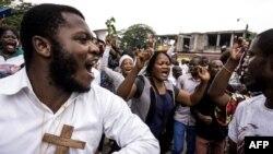 Abakatolika muri RDC mu myiyerekano mu mabarabara ya Kinshasa, itariki 31/12/2017.