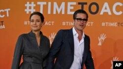 Angelina Jolie và Brad Pitt tại một sự kiện vào tháng 6/2014.