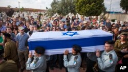 FILE - Israeli soldiers carry the coffin of Maj. Amotz Greenberg, 45, during his funeral in the Israeli city of Hod Hasharon, July 20, 2014. According to reports, Greenberg was killed fighting a group of militants who infiltrated Israel through a tunnel.