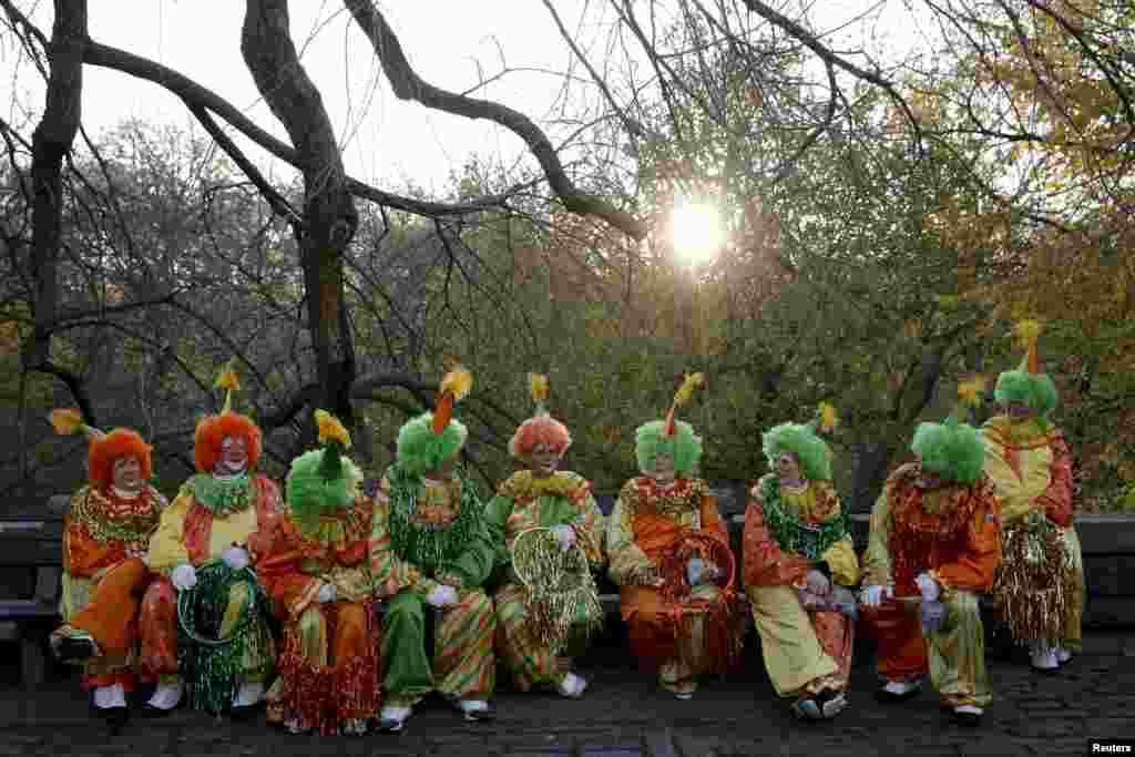 Clowns gather before the 89th Macy's Thanksgiving Day Parade in the Manhattan borough of New York.