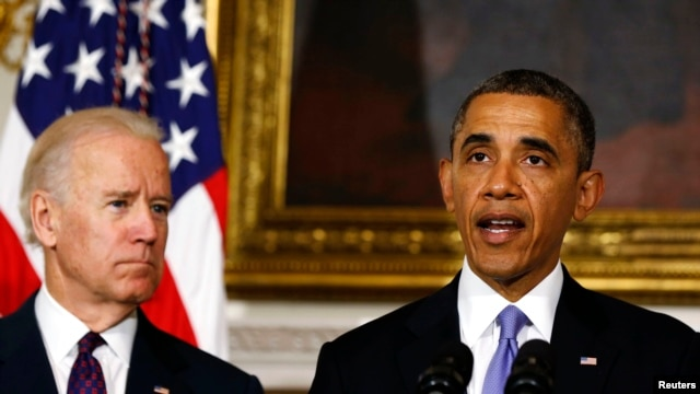 President Barack Obama speaks next to Vice President Joe Biden (L) at the White House in Washington, May 21, 2013.
