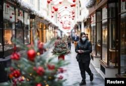 A woman walks through the Burlington Arcade adorned with Christmas decorations, amid the coronavirus disease outbreak, in London, Nov. 23, 2020.