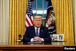 President Donald Trump speaks about the U.S response to the COVID-19 coronavirus pandemic during an address to the nation from the Oval Office of the White House in Washington, March 11, 2020.