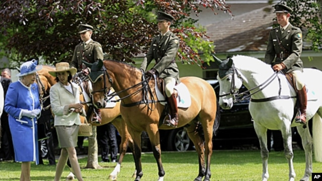 Britain's Queen Elizabeth II far left arrives at the National Stud Farm in Kildare, Ireland, May 19, 2011.