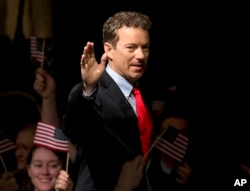 FILE - Sen. Rand Paul, R-Ky. arrives to announce the start of his presidential campaign, April 7, 2015, at the Galt House Hotel in Louisville, Kentucky.