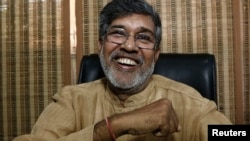 Indian children's rights activist Kailash Satyarthi laughs at his office in New Delhi October 10, 2014.