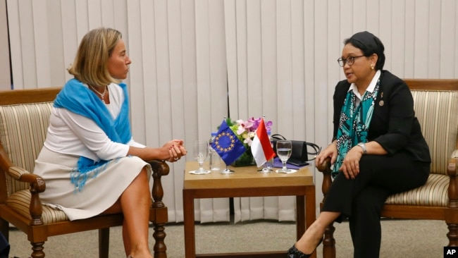 FILE - European Union Foreign Policy Chief Federica Mogherini, left, and Indonesian Foreign Minister Retno Marsudi talk during a meeting on the sidelines of the 50th ASEAN Foreign Ministers' Meeting and Related Meetings in Manila, Philippines, Monday, Aug. 7, 2017.
