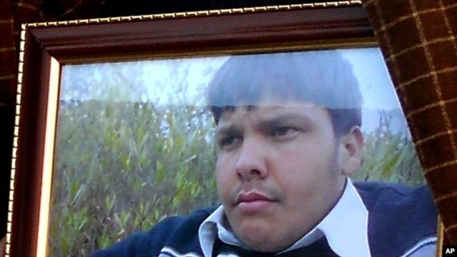 An undated framed photograph shows 15-year-old Pakistani student Aitzaz Hasan, who residents and police say died this week while trying to stop a suicide bomber who was targeting his school in a remote village in Hangu, Pakistan, Jan. 10, 2014.