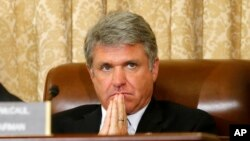 FILE - House Homeland Security Committee Chairman Michael McCaul, a Texas Republican, listens during a committee hearing on Capitol Hill in June 2014.