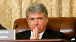 FILE - House Homeland Security Committee Chairman Michael McCaul, R-Texas, listens during a committee meeting in June 2014 on Capitol Hill.