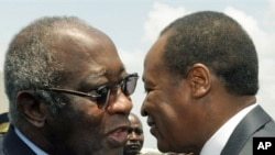 Ivorian president Laurent Gbagbo (L) and Burkina Faso's president Blaise Compaore meet at the airport in Abidjan on 22 Feb, 2010 after Campaore arrived to act as a mediator in Ivory Coast's political crisis