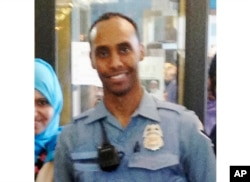 In this May 2016 image provided by the city of Minneapolis, Officer Mohamed Noor poses for a photo at a community event welcoming him to the Minneapolis police force.